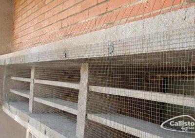 Pose de grille et de pics anti-pigeons
